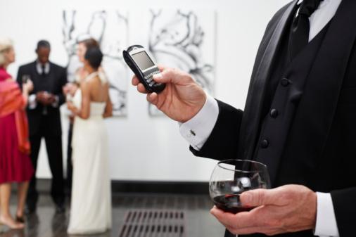 BoB NYC Art Galleries - Man Holding phone & wine